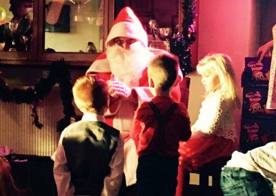 Children enjoying a visit from Santa at St Annes CC in 2017