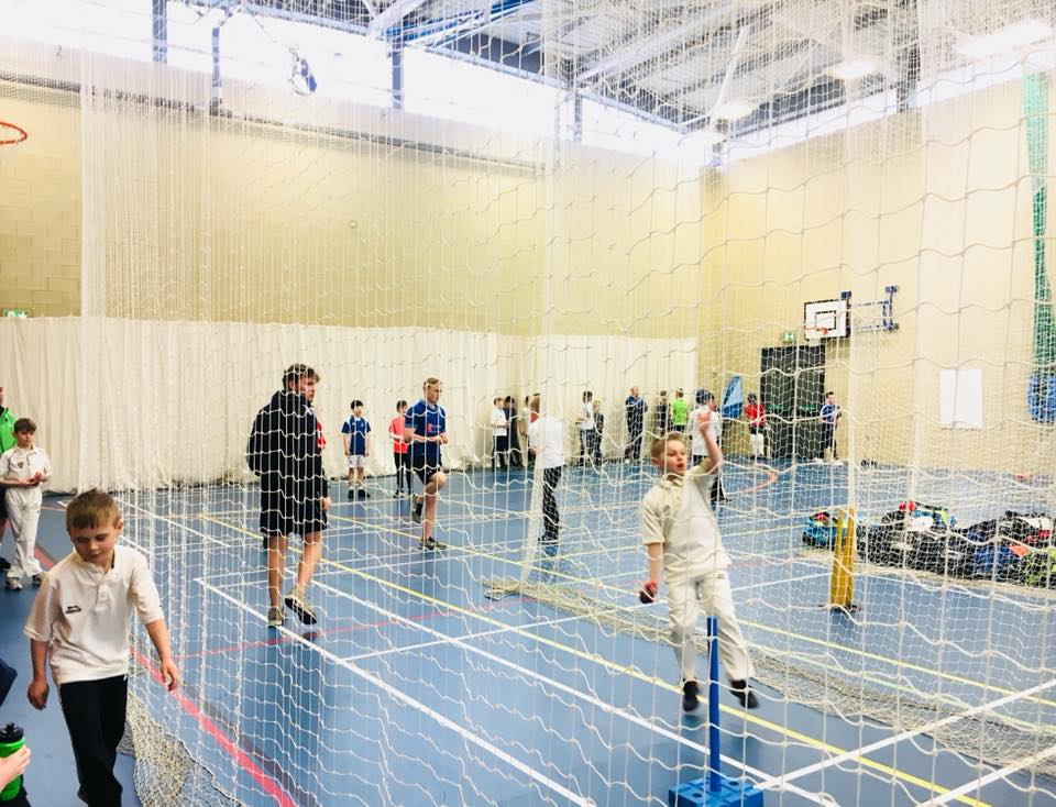 Junior player practicing bowling at St Annes CC indoor nets